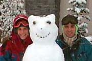 Cathy and Tom with a snowman