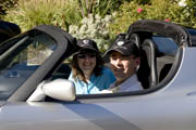 Tom and Cathy in a Tesla Roadster