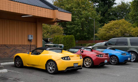 3 Roadsters Sharing the Charging Station at Burgerville